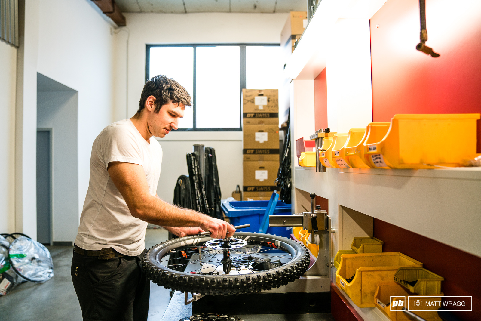 The wheels are all hand-assembled here with the rotors cassette and tyre all mounted and checked by a technician.