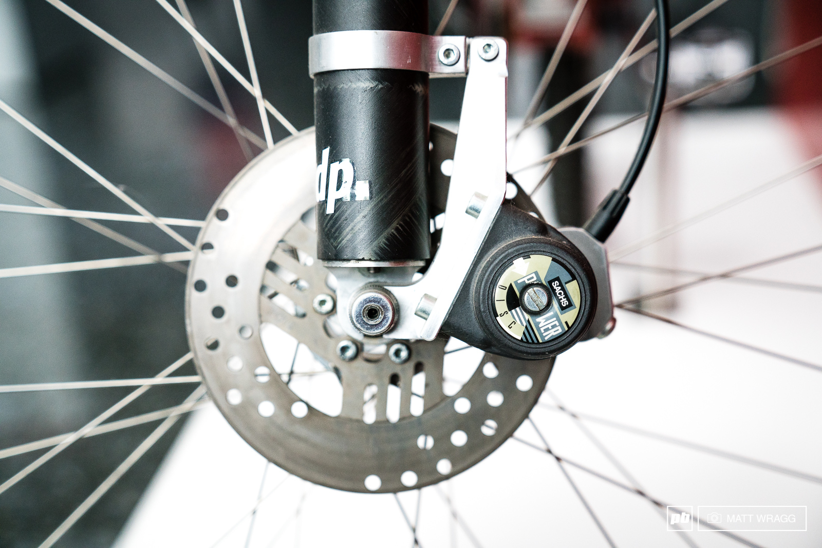 They were keen on the idea of disc brakes although these Sachs brakes never really cught on. This was also a time before standardised brake mounts - so check out the custom mounting solution.