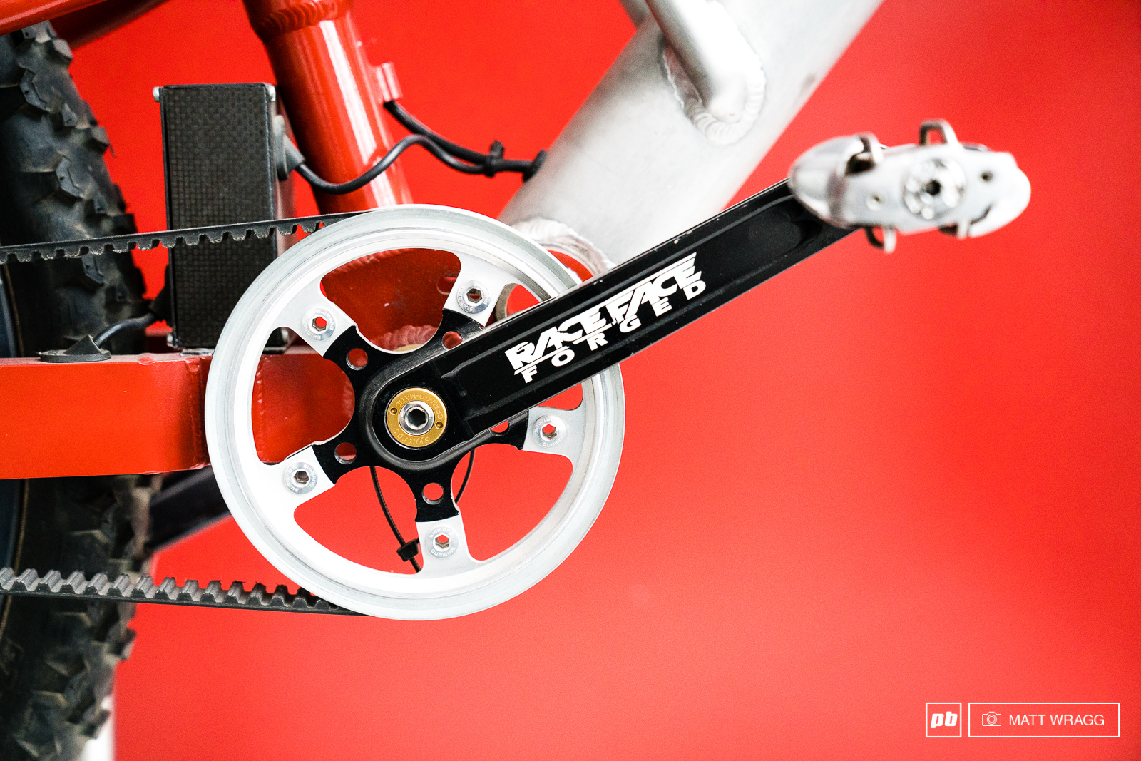 They constructed a special chainring to accomodate the belt and mounted it to a standard Raceface crank.