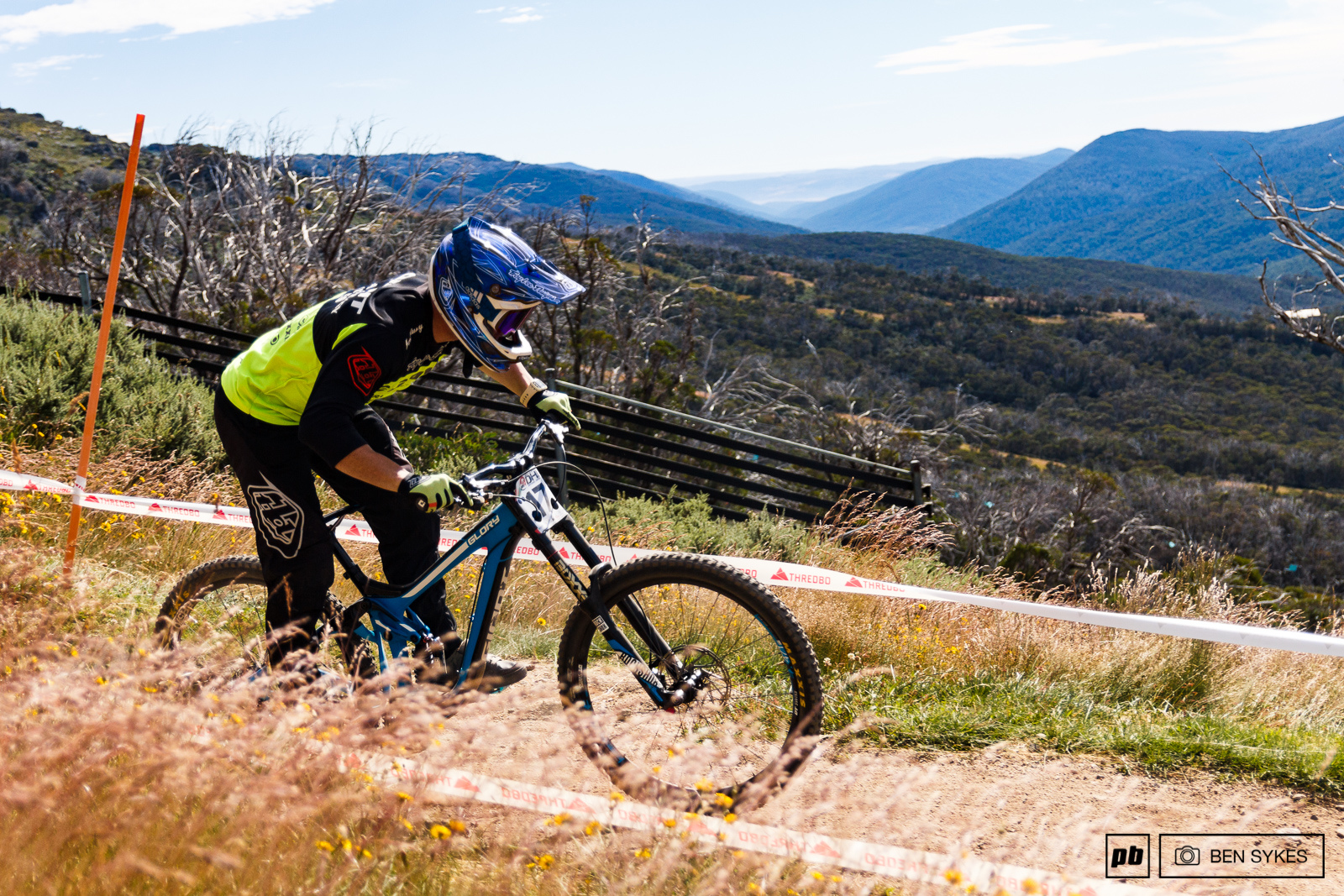 Riding across the top of Thredbo DH with the Thredbo valley in the background