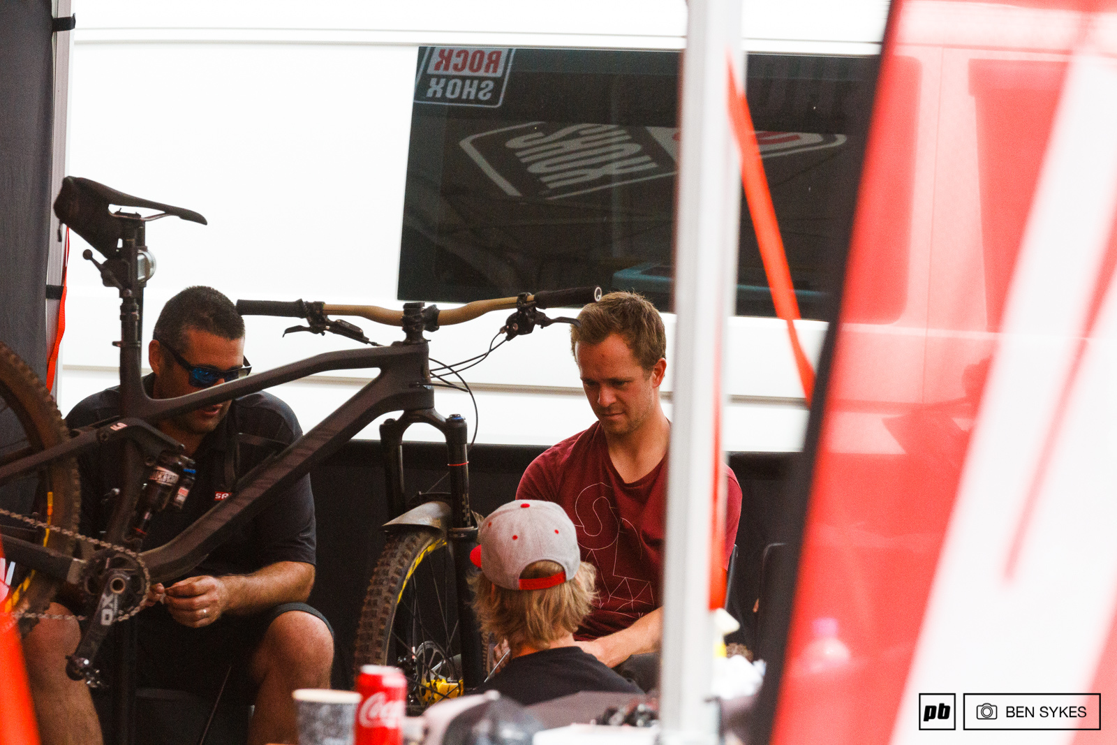 Brosnan enjoying some downtime in the pits.