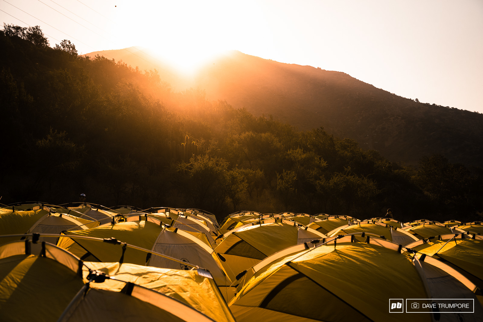 The sun sets on the tent city that has formed in a valley just below the Andes. When it rises again in the morning rcaers will head into the mountains for the first day of racing.