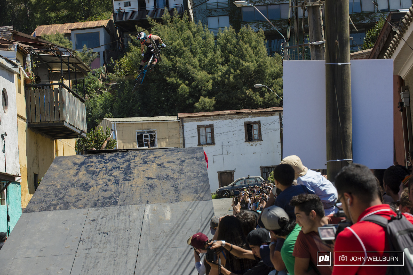 Chilean rider Ignacio Rojo is the only competitor that has competed in every single one of the 15 Cerro Abajo Urban DH races in Valparaiso. Here he gets full moto over the 40 foot bus gap.