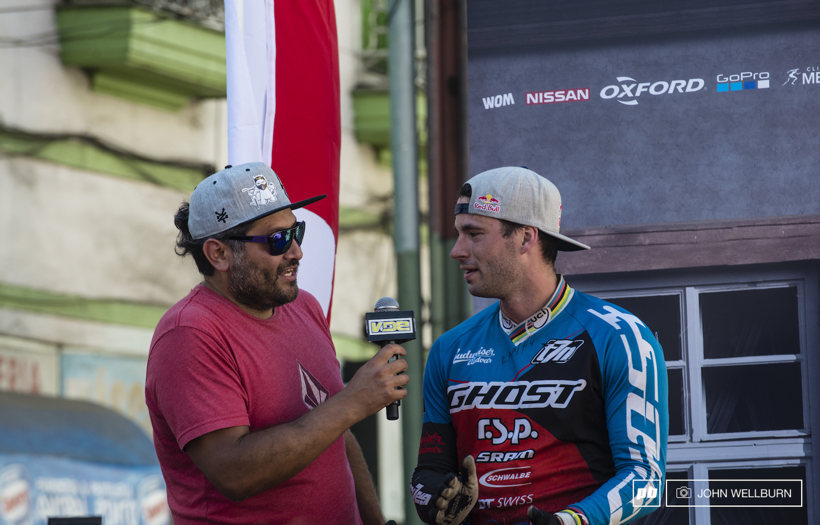Tomas Slavik jumps on stage for an interview seconds after taking the win.