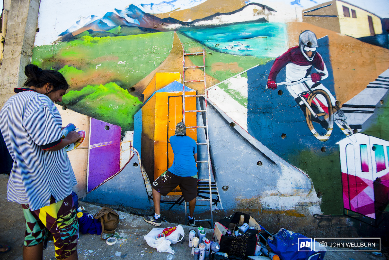 Mural artists work hard in Valparaiso. The city is covered with some of the best mural art in the world. Here artists prepare a custom mural for the 15th Anniversary edition of Valparaiso Cerro Abajo