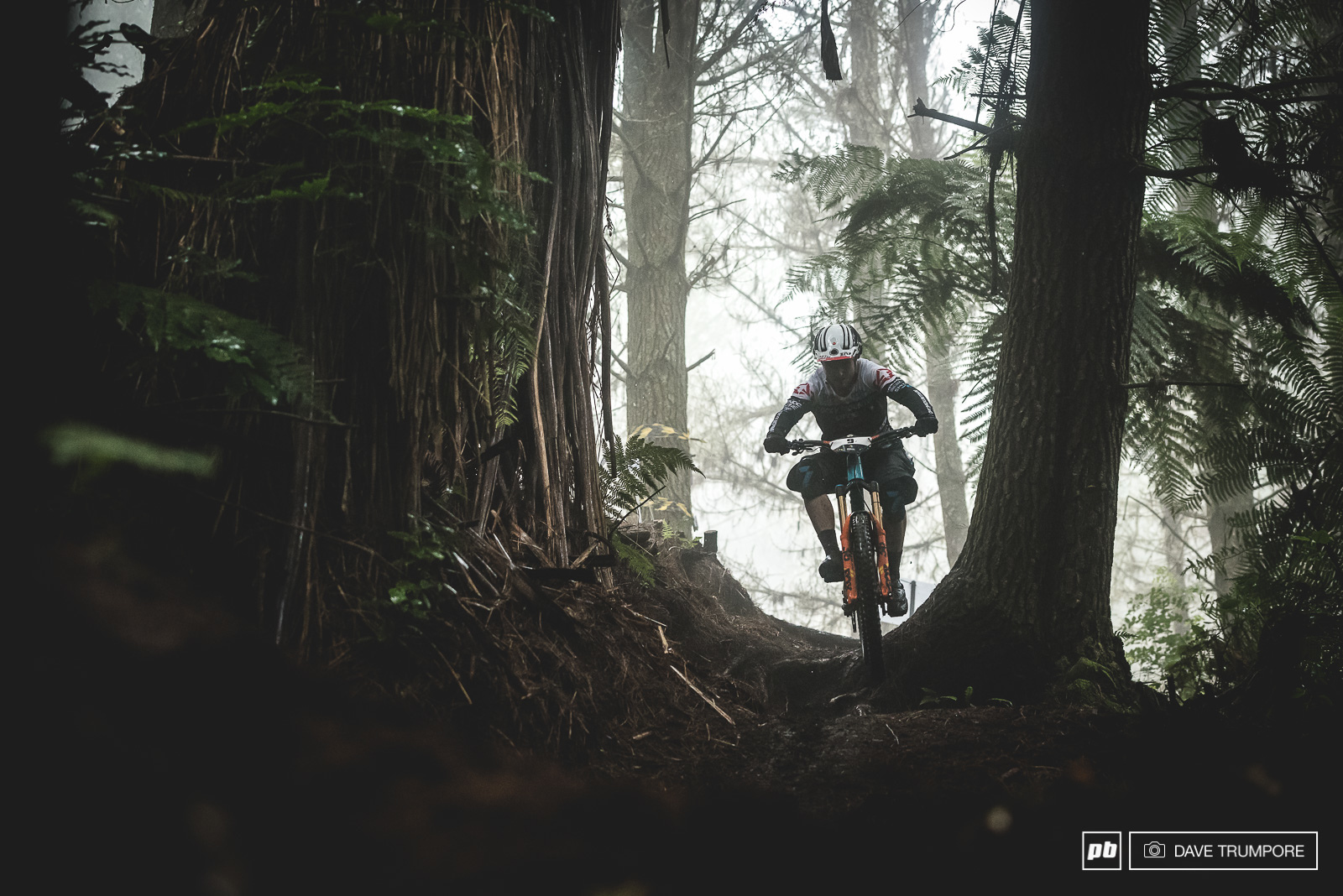 Jesse Melamed drops into the slippery woods on stage 1.