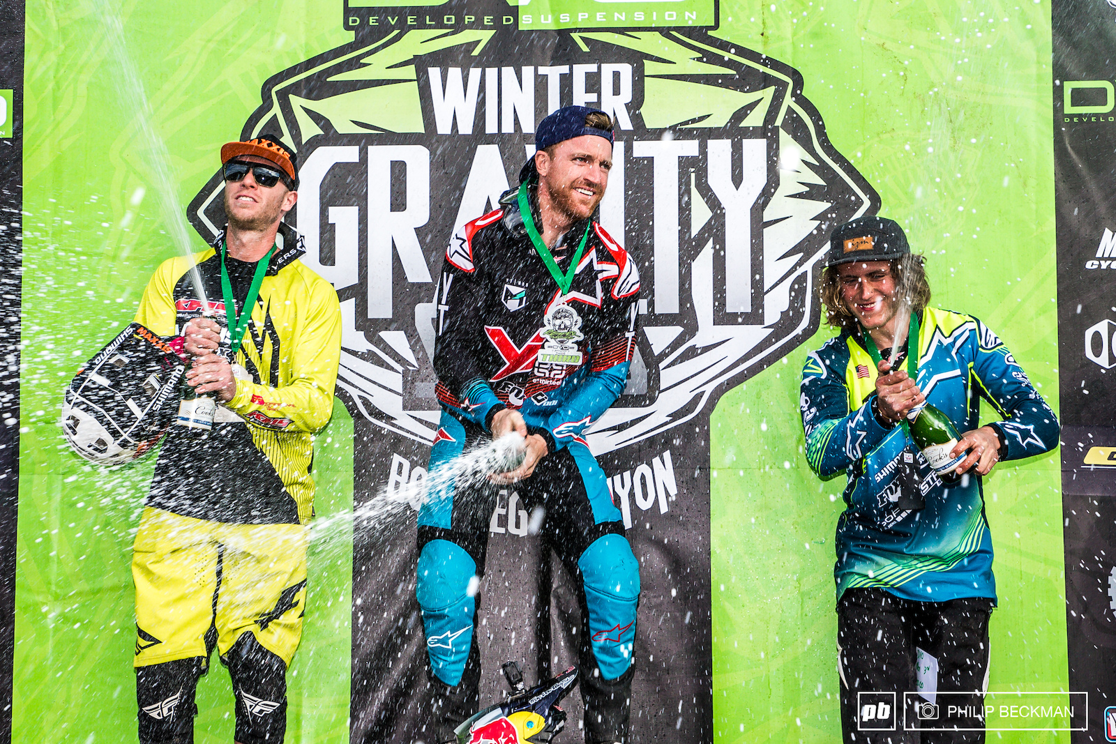 Time for the Pro Men s bubbly. At the DVO Reaper Madness it was l-r Logan Binggeli KHS Factory Racing Aaron Gwin YT Red Bull and Demetri Triantafillou Lake Town Bicycles popping the corks.
