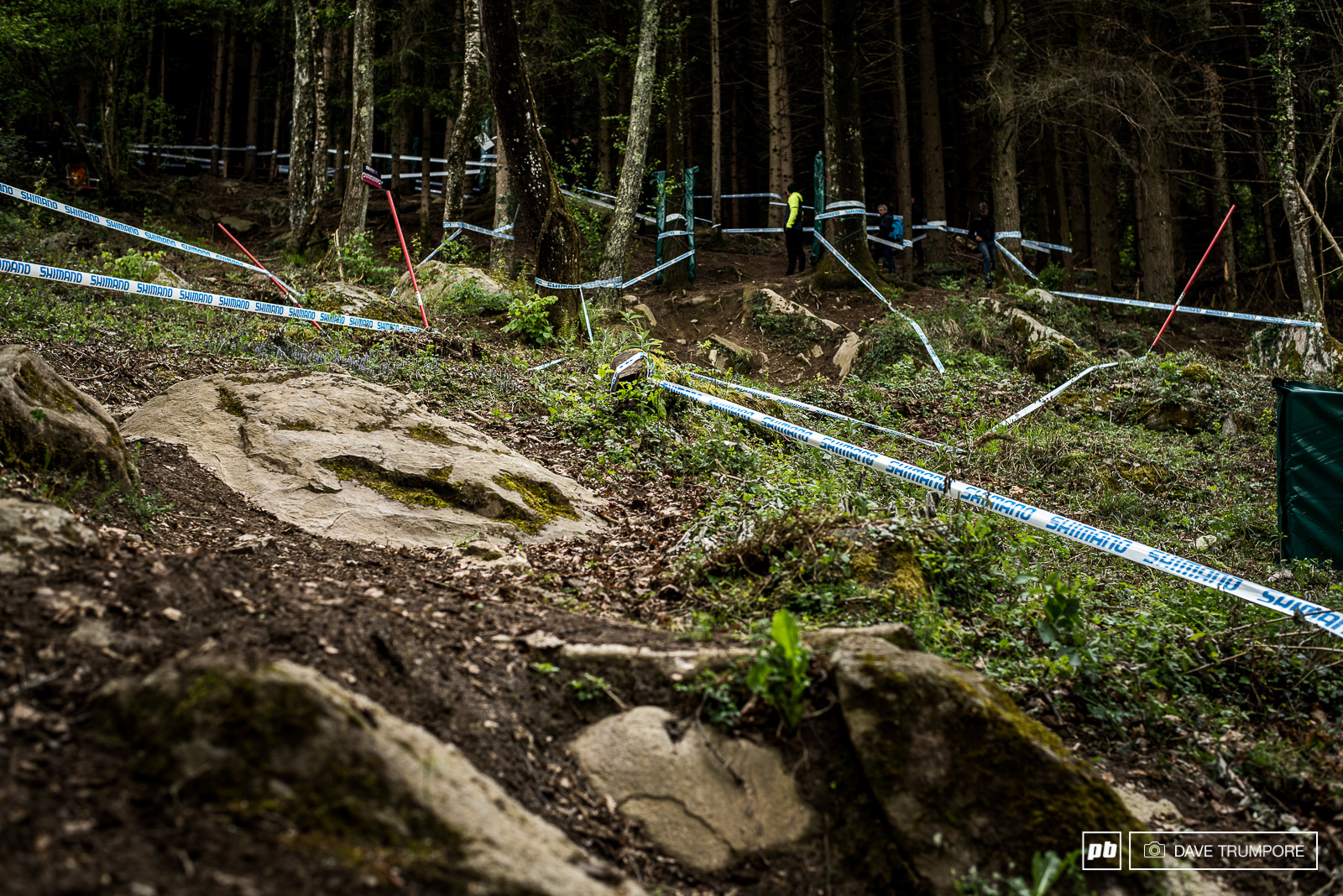 other than a brief flat straightaway near the top of the course the track in Lourdes never lets up. Throwing rocks roots and corners at riders in succession all the way to the bottom.