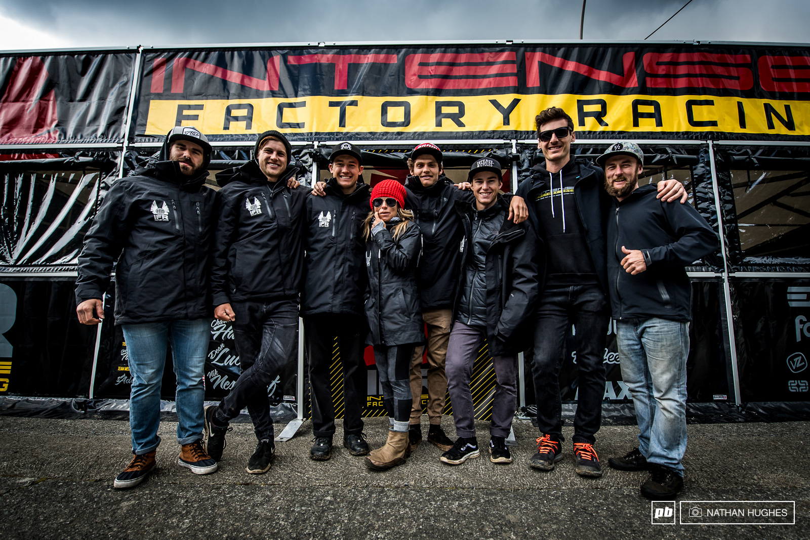 The complete Intense Factory Racing crew in front of their shiny new pit set-up.