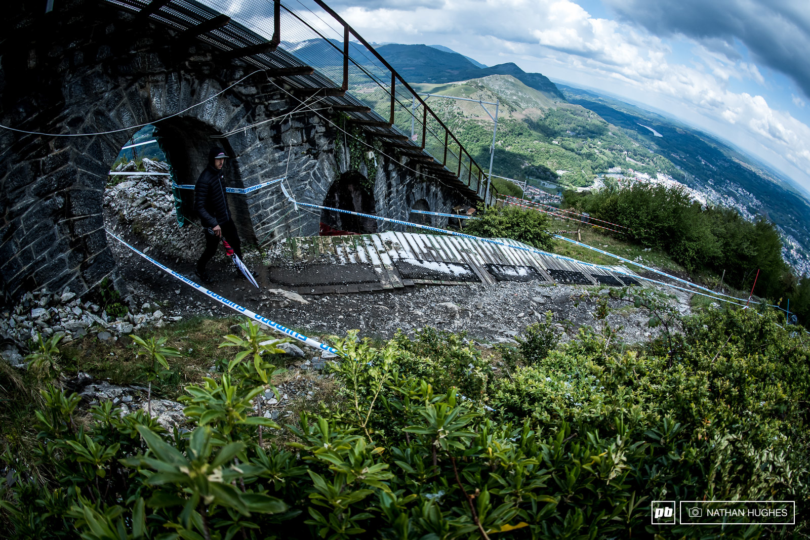 Gee Atherton strides forth under the troll bridge high above Lourdes.