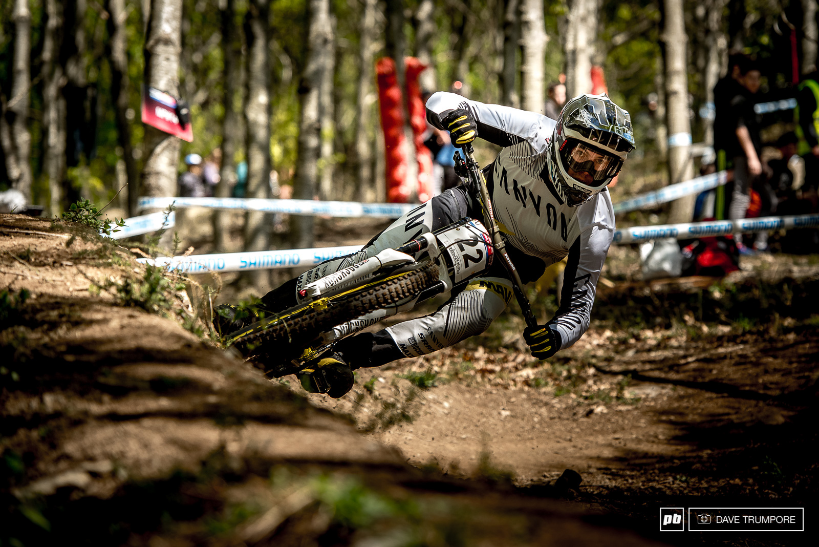 Mark Wallace leans his new Canyon through one of the fast berms half way down the track.