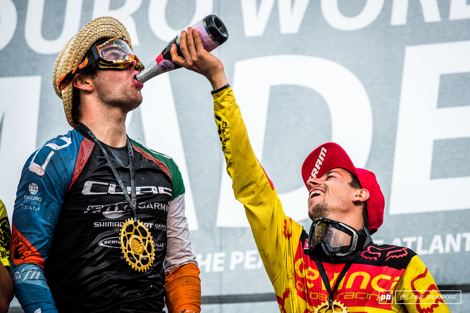 Friends make sure friends drink their share when on top of the podium.