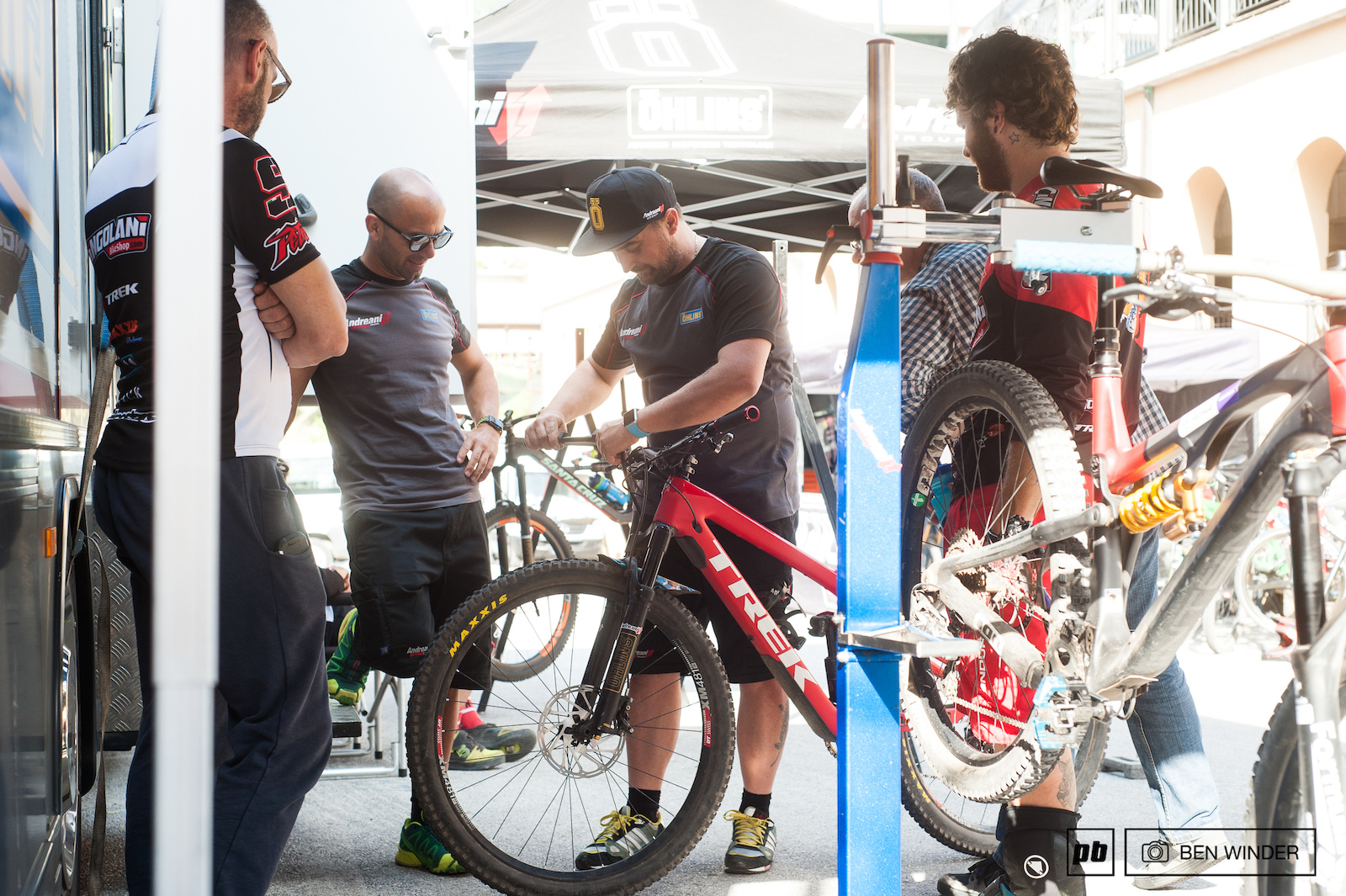 But of course there s a mountain bike race going on Alex Lupato setting up his forks with the Andreani guys.
