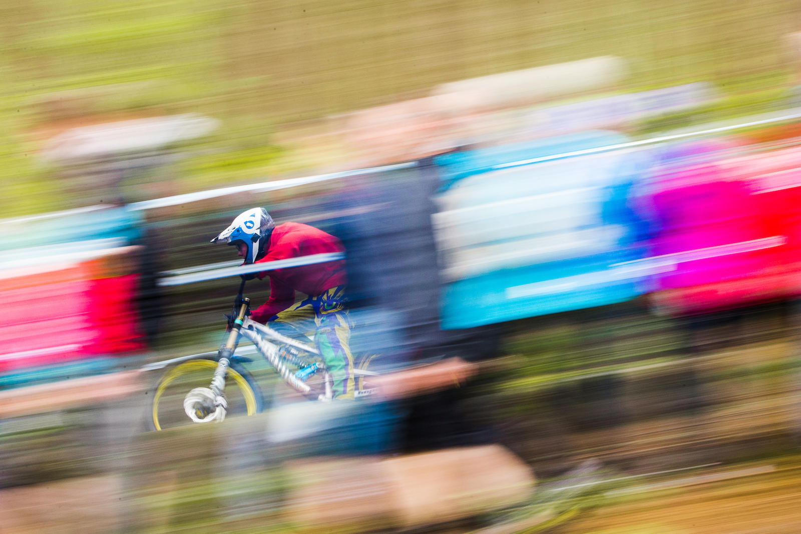 Speed blur through the endless wall of spectators.