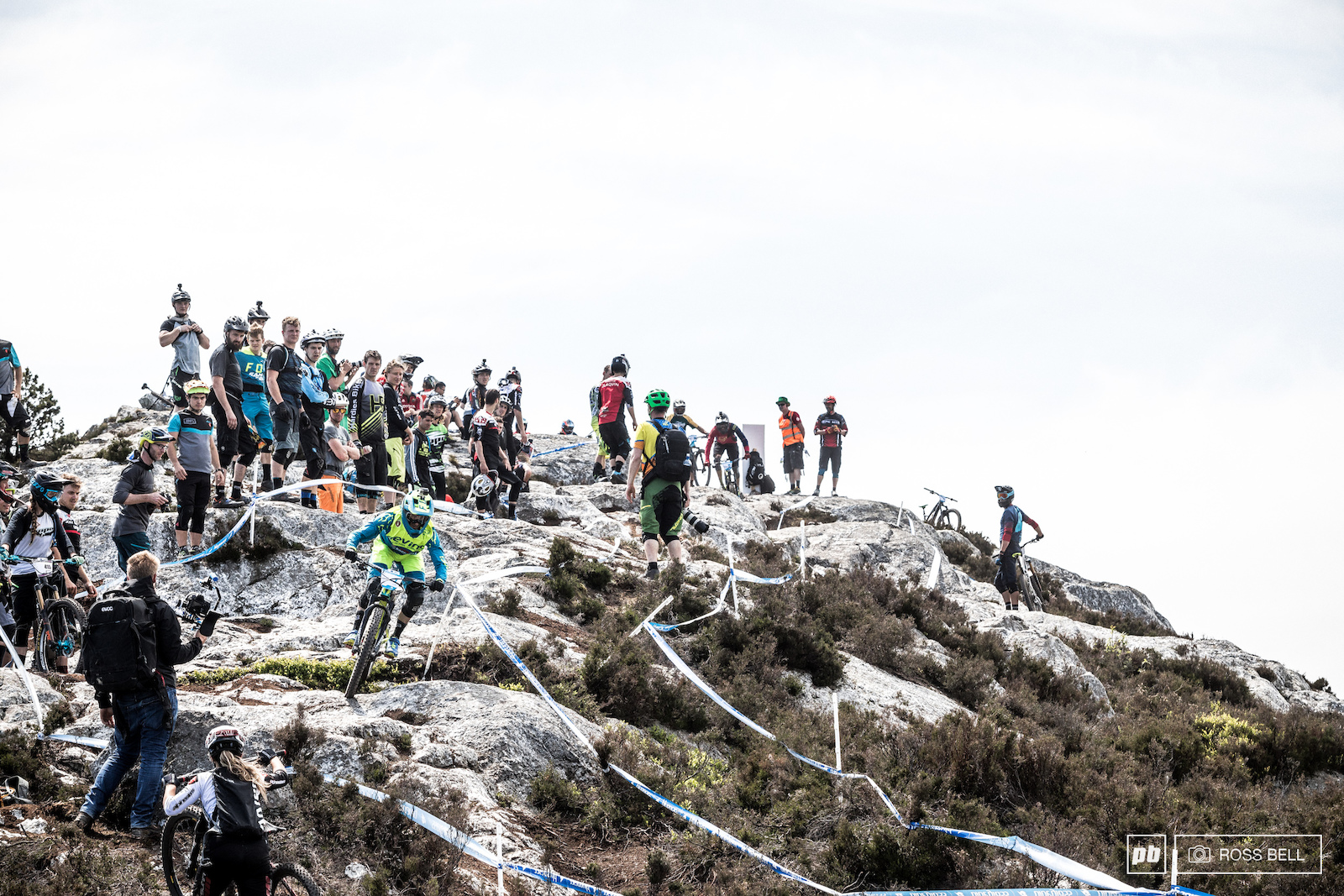 The top of stage three has become almost an iconic part of the EWS Damien Oton negotiates the slabs and fellow racers.
