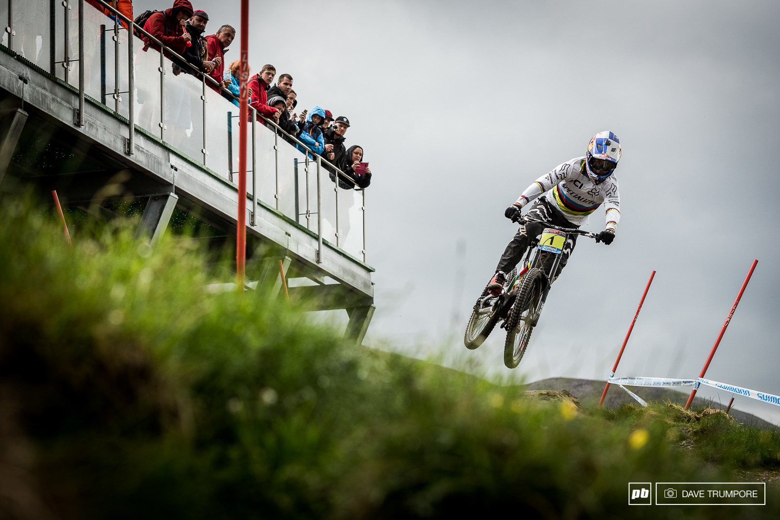 The crowds made it all the way tot he top to cheer as Finn Iles drops into the track on his qualifying run.