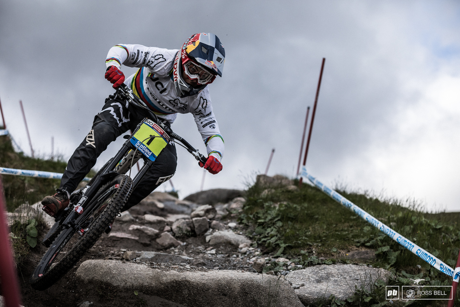Finn Iles riding the classic track of Fort William complete with the rainbow jersey in 2017.