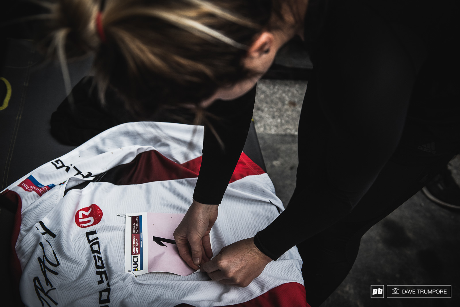 Tracey Hannah taking a few minutes to enjoy pinning the number one plate onto her World Cup leader s jersey. It s been a while since we ve seen anyone but Rachel Atherton in this piece of kit.
