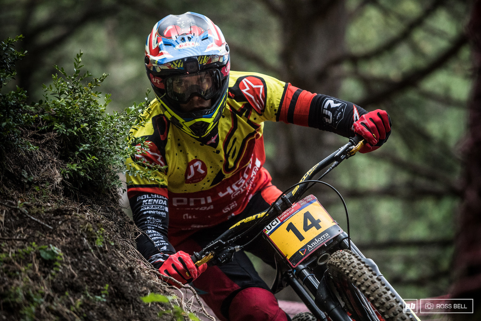 With such small margins separating the riders you ve got to be sure to shave as close as you dare to any imposing trail side feature. Sik Mik matching his number board with a 14th place finish.
