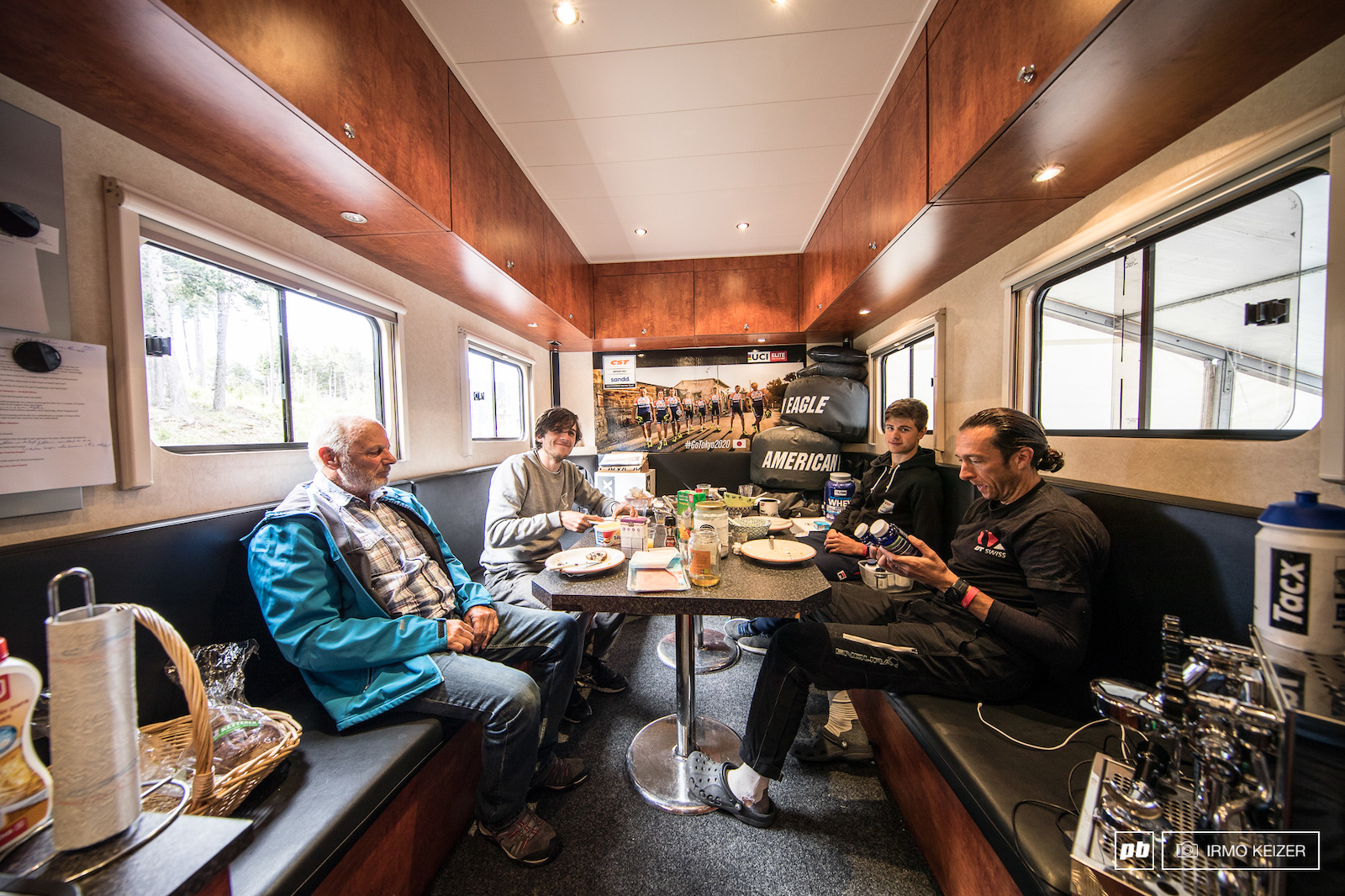 The inside of the truck houses a second seating area often used for breakfast for the team staff as well as for meetings.