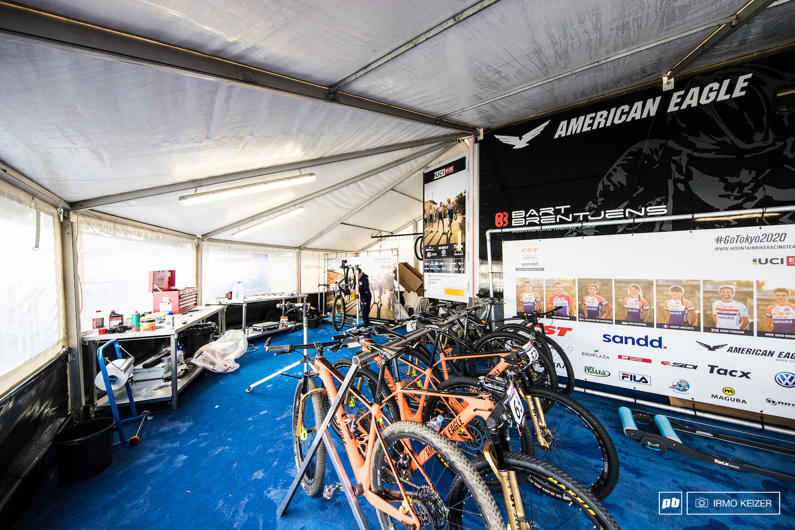 Inside the space is divided into three distinct areas. The left part is setup for the team s two mechanics. Riders bikes which are ready to ride are hung in the rack and there s space for riders to warm up on the rollers. The mechanics have direct access to spare parts and bikes via the truck s back door.