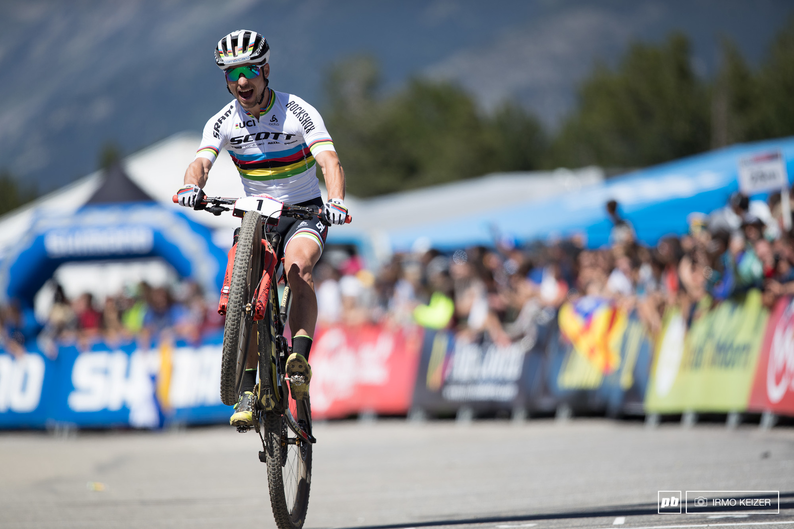 Schurter rode back to the line for a victory hop.