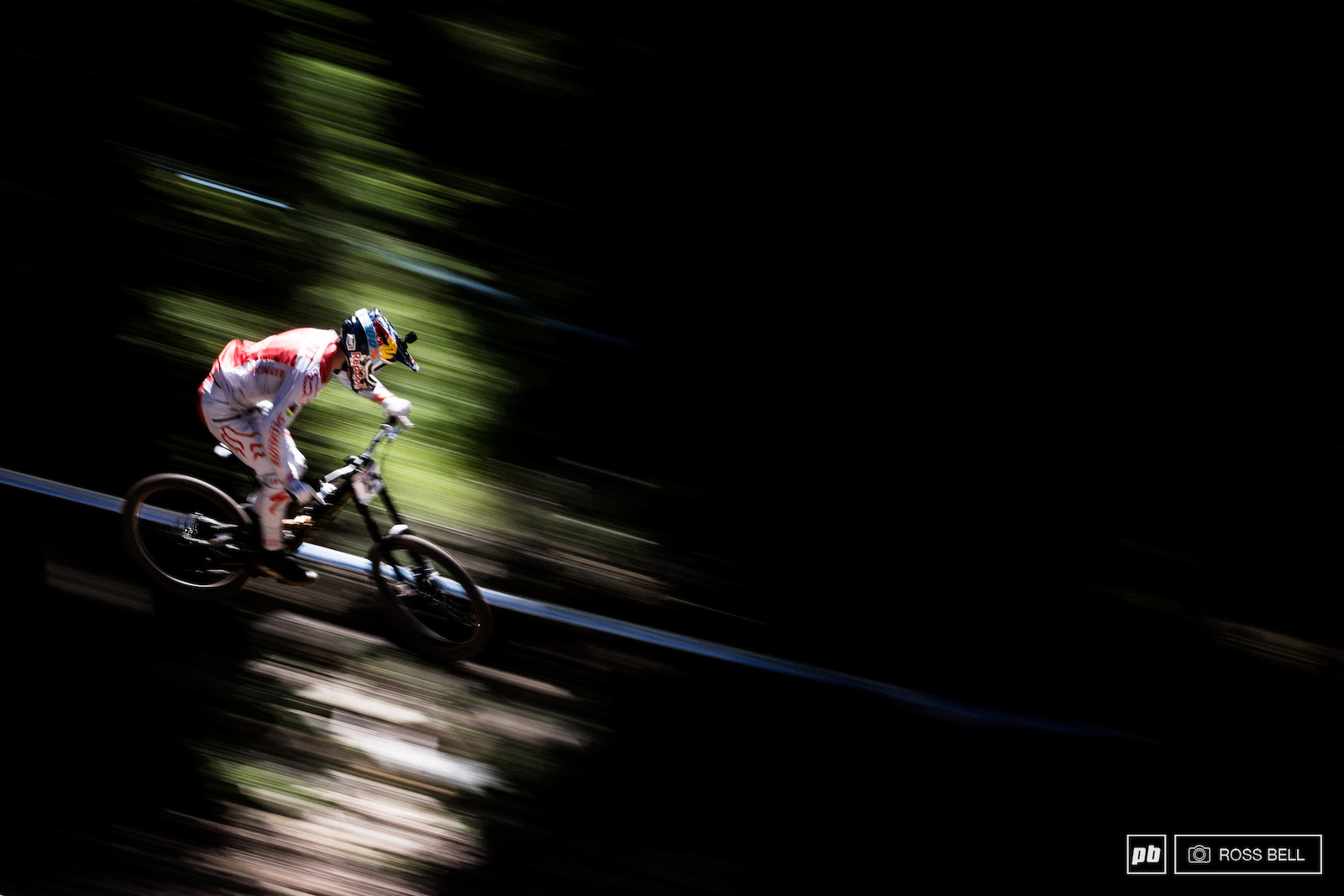 There was little escape from the baking sun today Loic Bruni flickering through the bright light patches that hotspotted the woods.