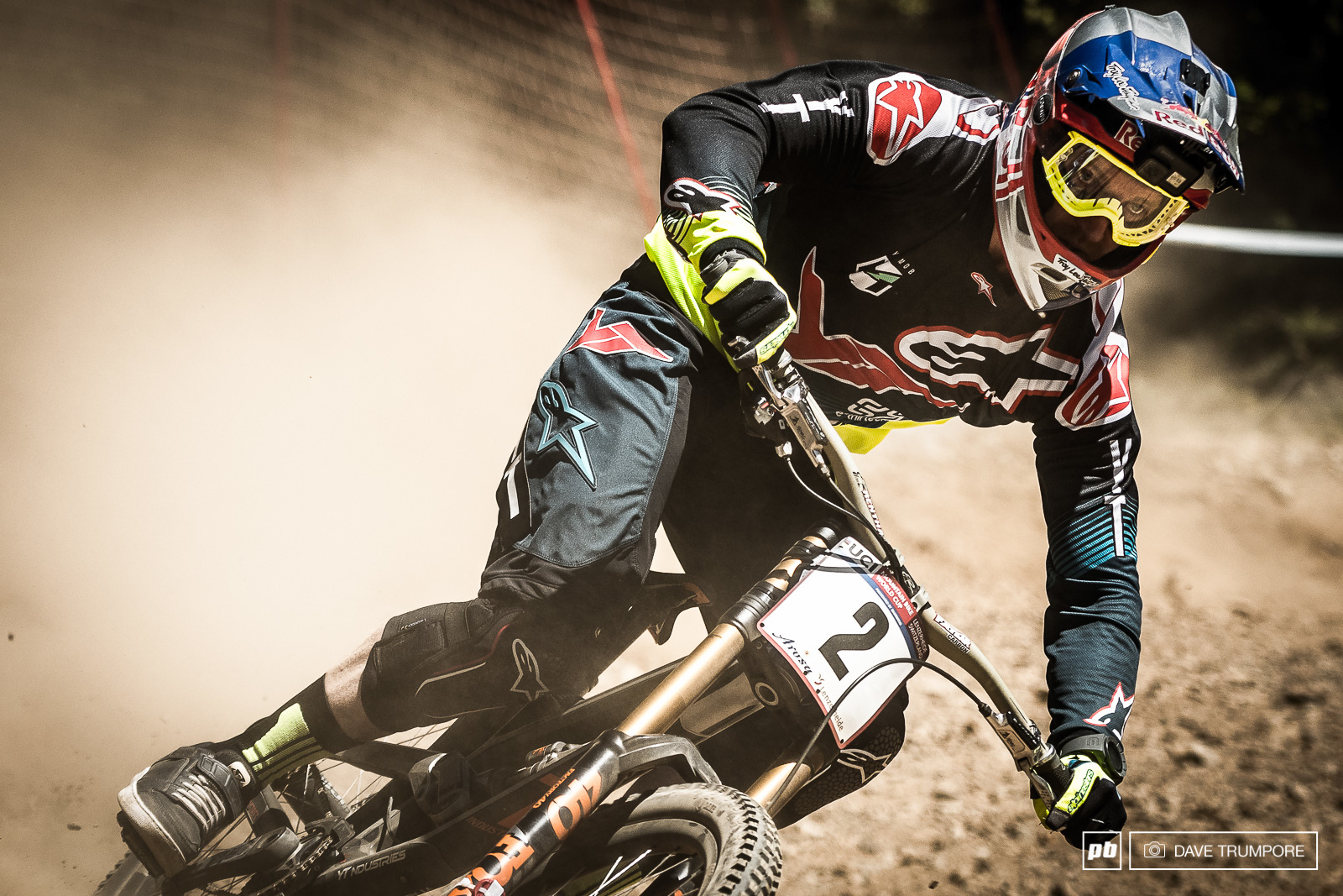 Aaron Gwin drifting about in the dust.