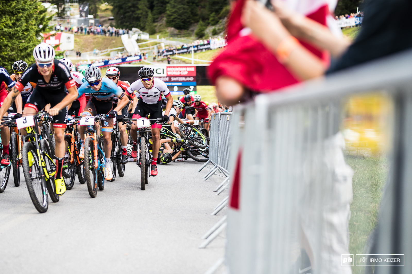 The men s U23 start saw a double crash piling riders up.