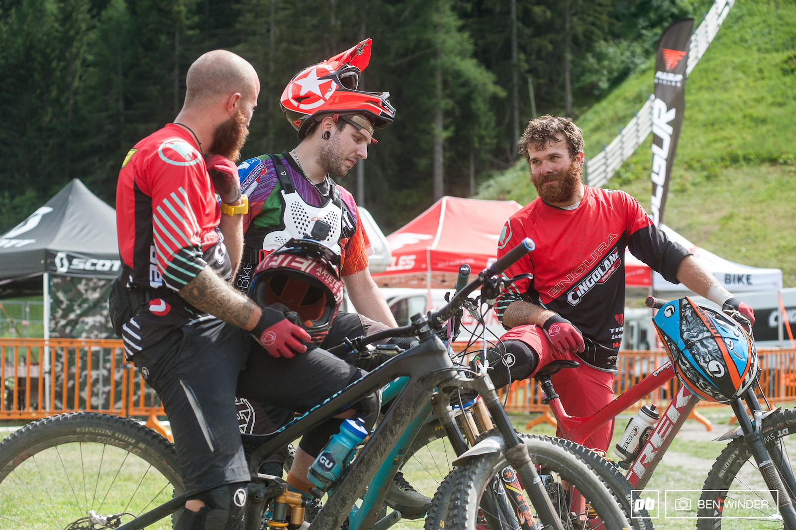 The Lupato brothers discussing the trails at the end of the day.