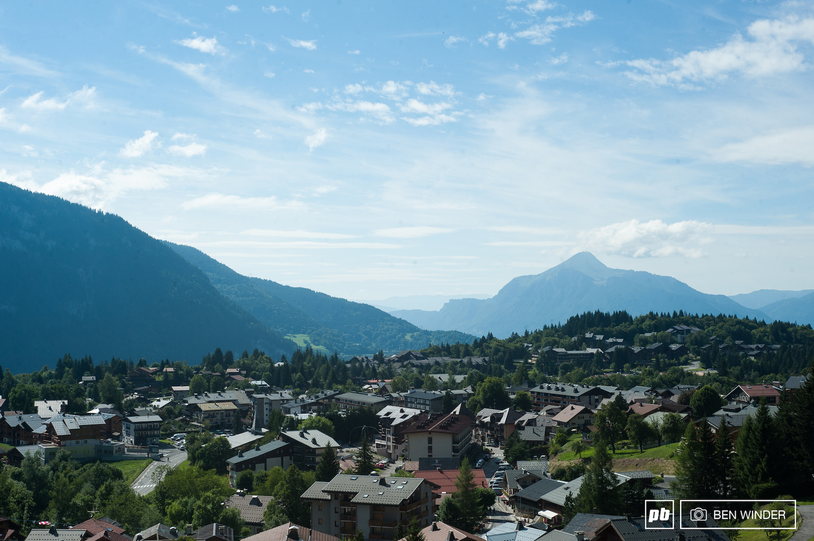A little picturesque town parked on the edge of the Alps.