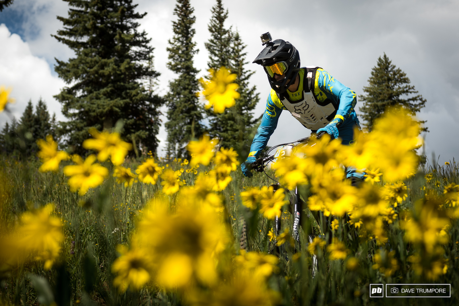 Damien Oton amongst the wild flowers and trying to find some air. With the start of stage 2 at just over 11k feet oxygen is limited.