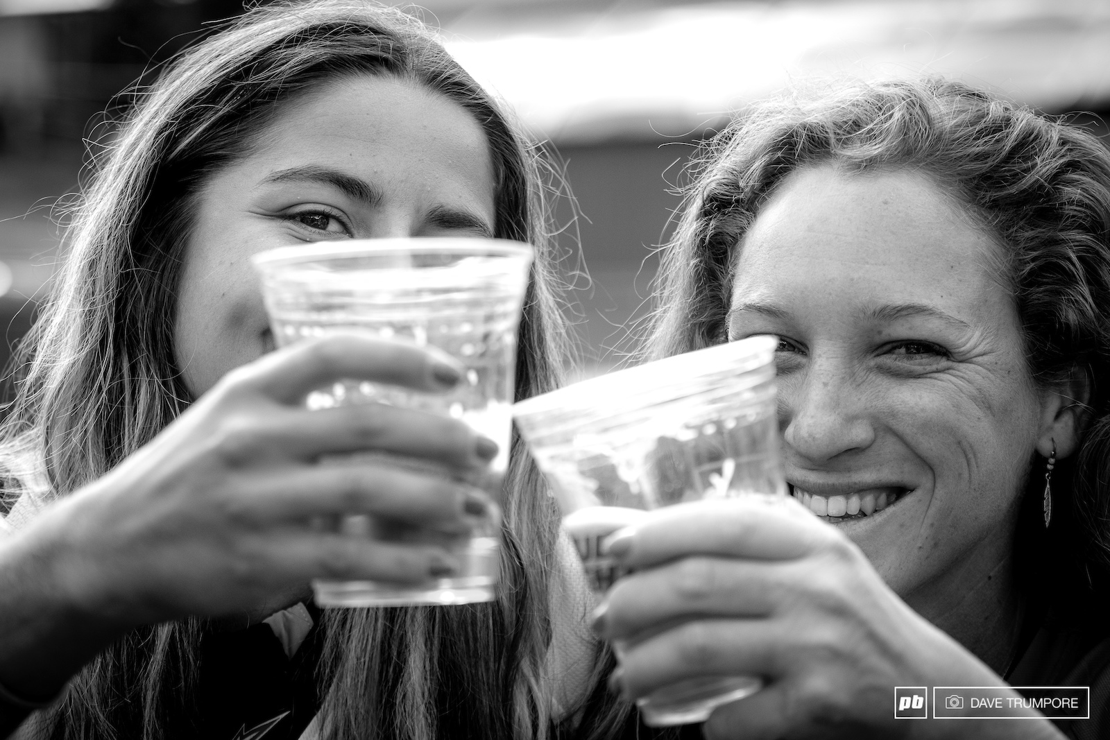 Isabeau Courdurier and Noga Korem rehydrate with some cold beer after a very long and hot weekend of racing in Aspen.