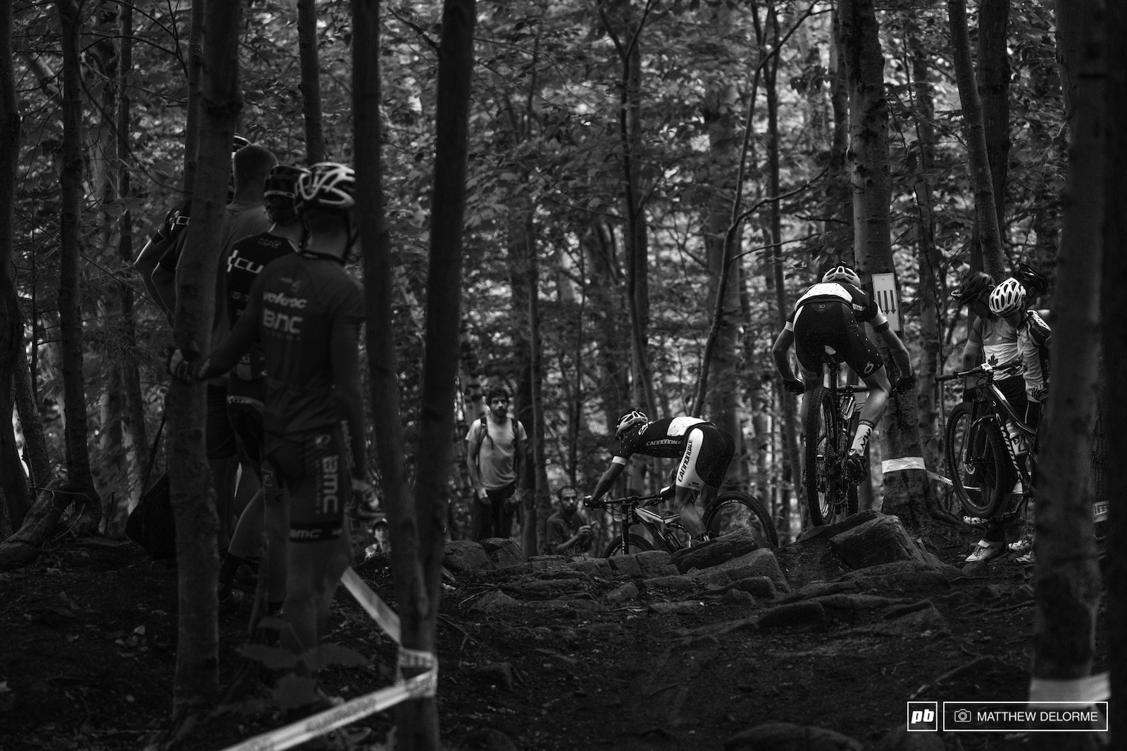 The Cannondale crew giving a lesson to onlookers on how to use speed to stay on line though slick rocks.