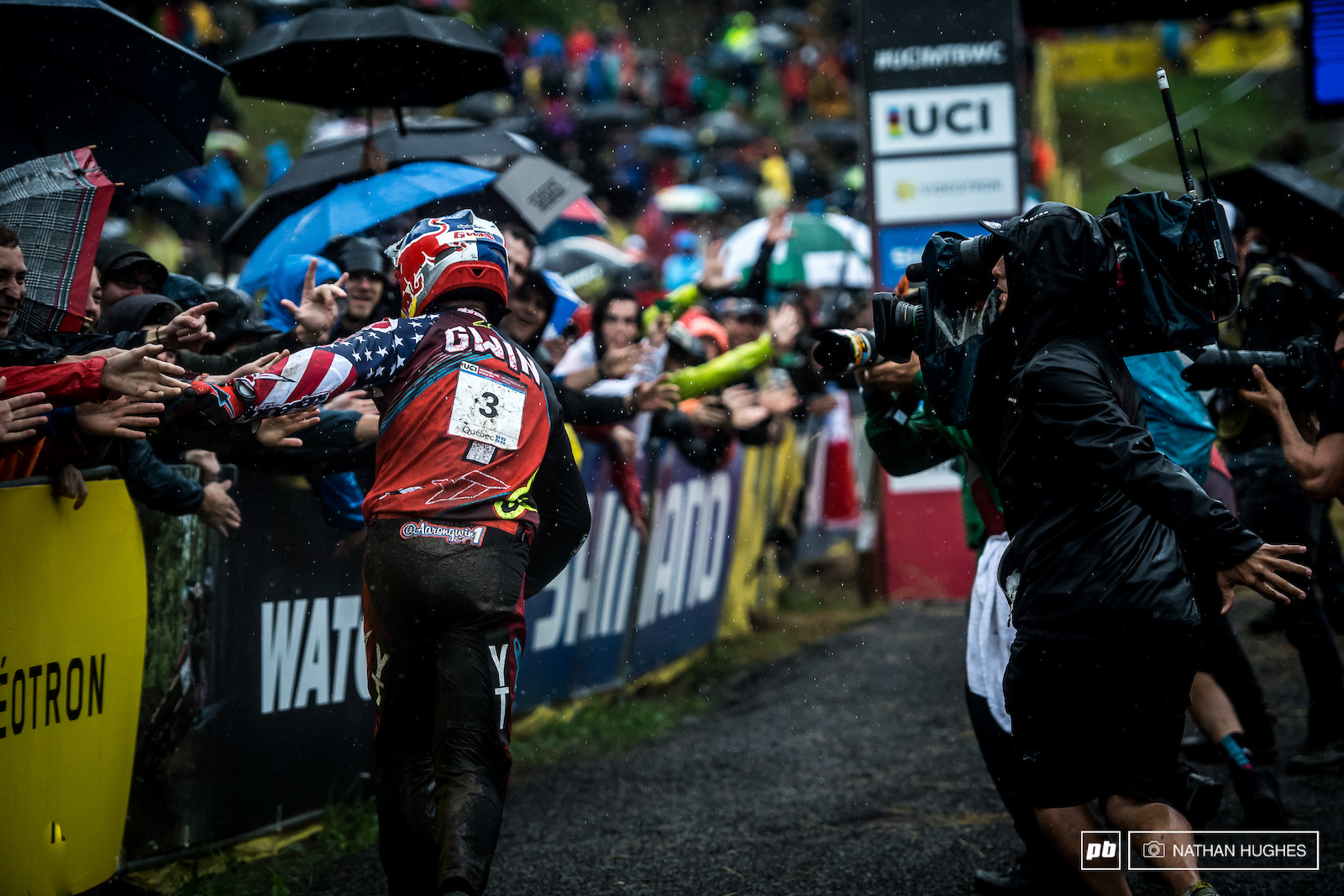 Gwin sheds the bike to celebrate in the still pouring rain.