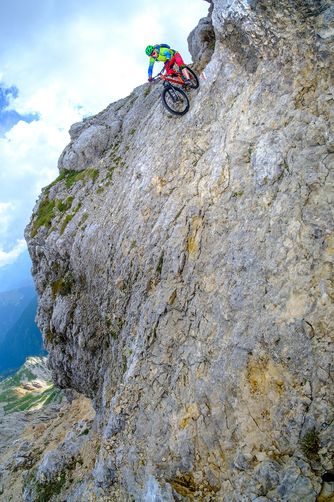 Steep riding in a no fall zone coming down from the Latemar sptize, Dolomites.