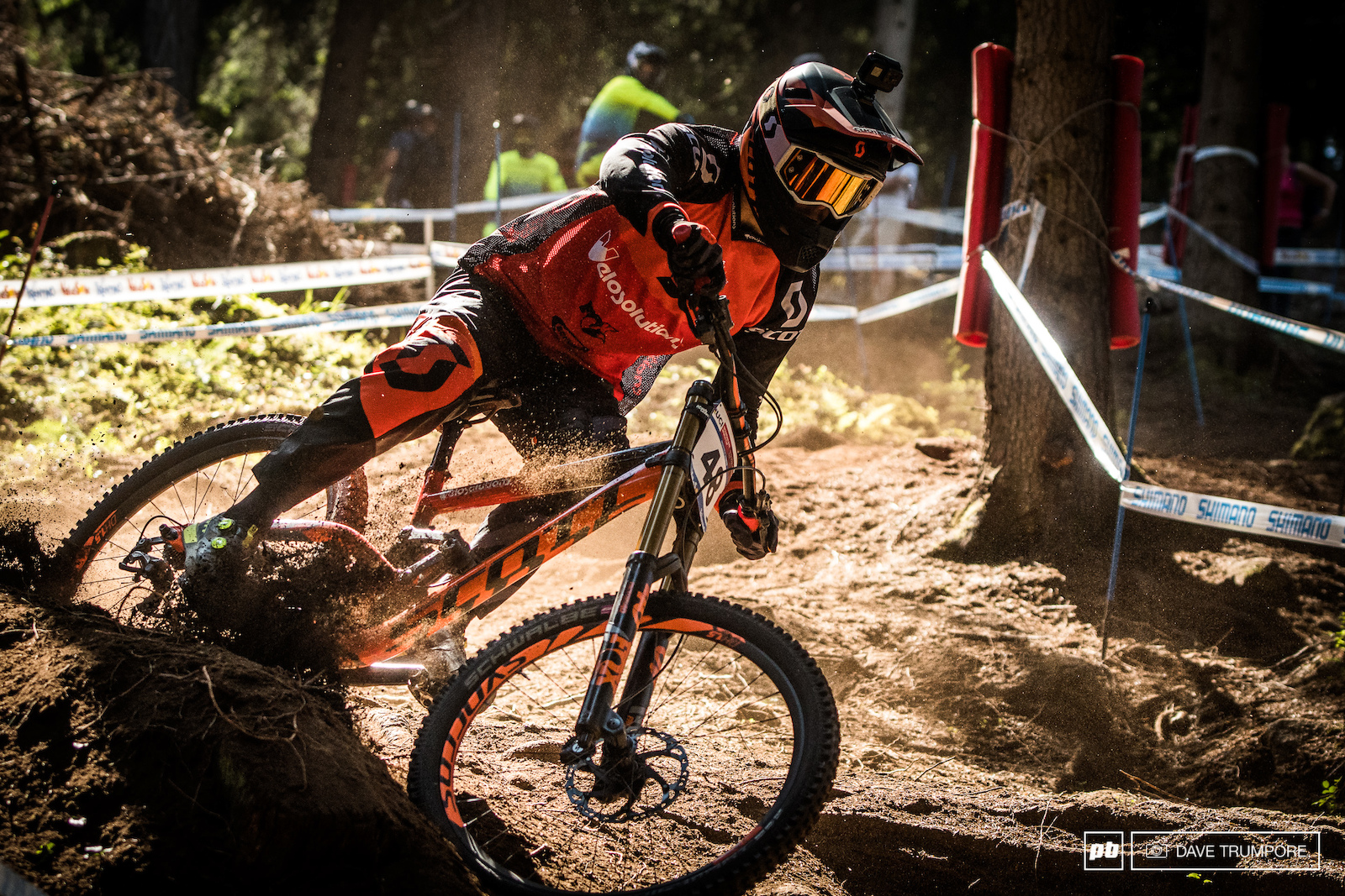 Gaetan Vige roosting his own top tube as he enters the first section of woods.