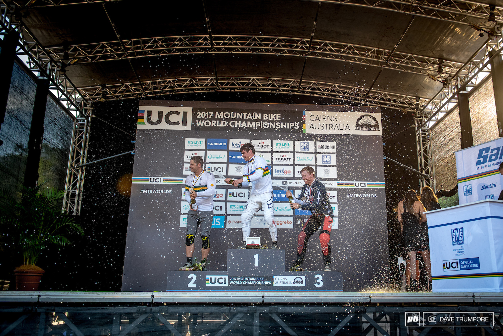 Loic Bruni Mick Hannah and Aaron Gwin wash off the dust from atop the podium.