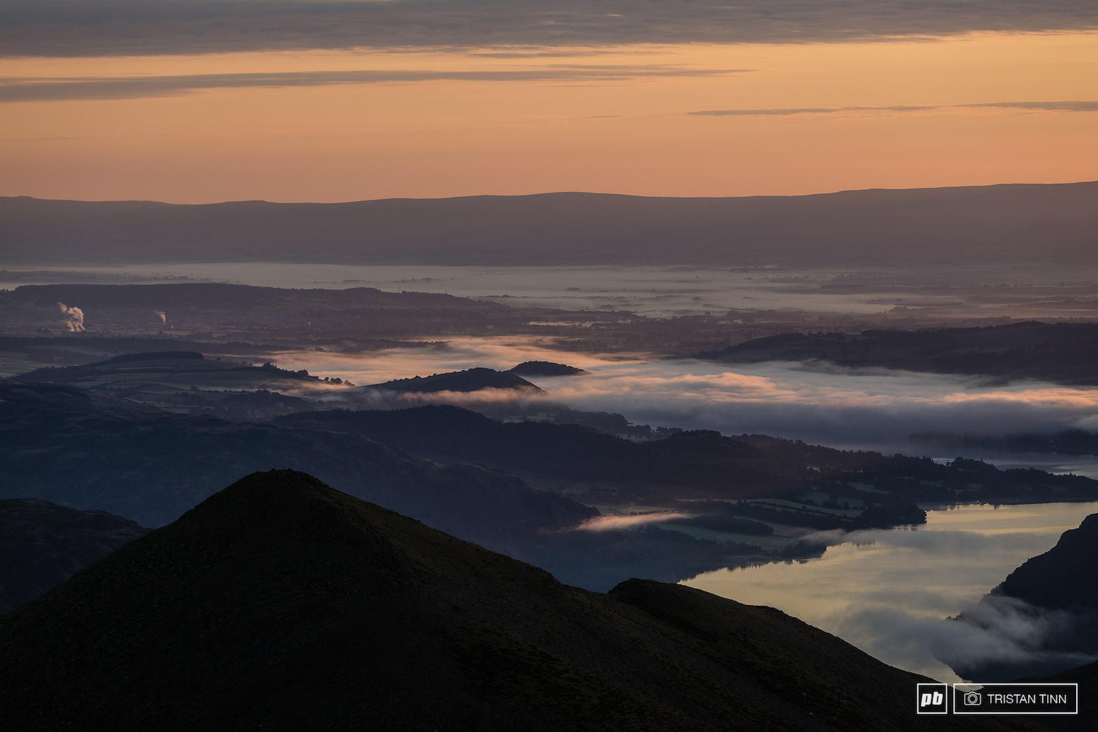 Mist is draped over ullswater with Penrith in the distance