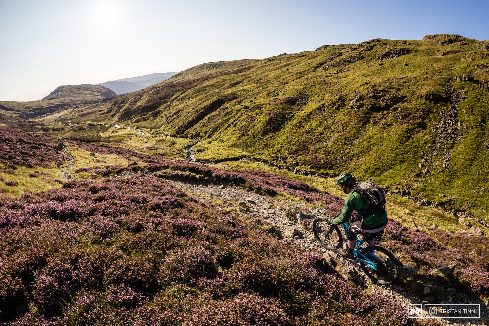 Lush heather lined singletrack following the water course