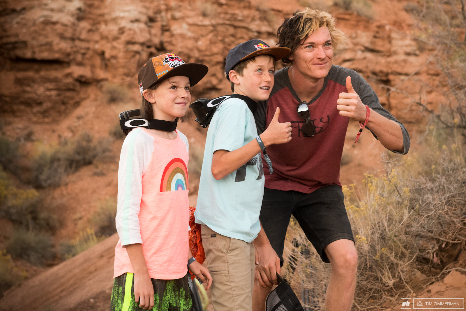 Tomas Genon poses for a photo with frothing groms Ethan and Beatrice.