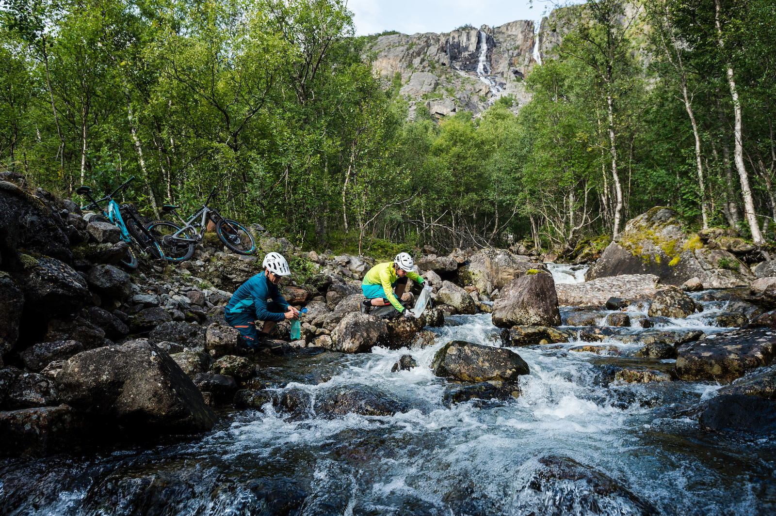 Mikael af Ekenstam and Joey Schulser refilling their water bottles near Rombak Norway.