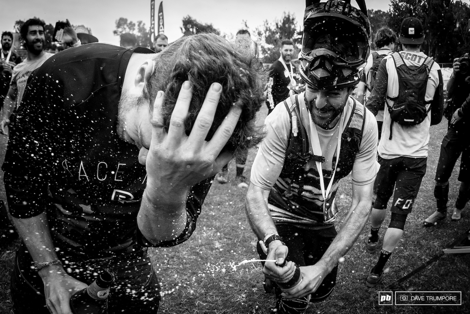 Iago Garay gives Jesse Melamed a cold beer shower to wash off the just in the finish area.
