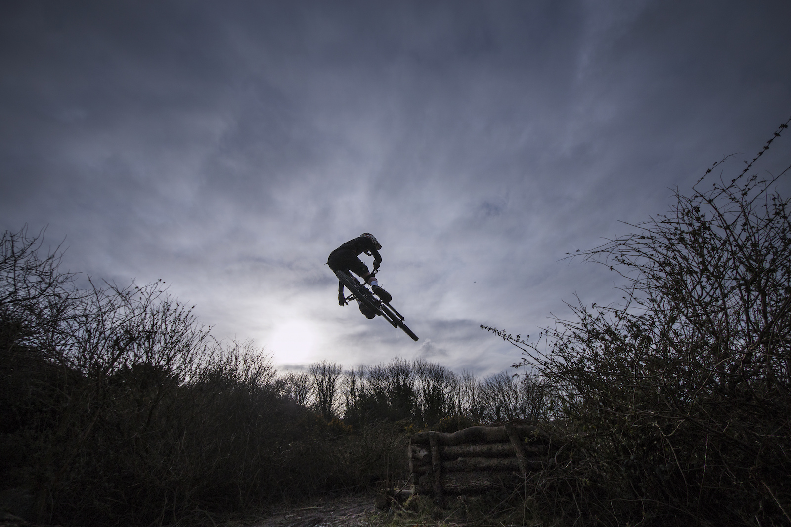 I was about to pack up and go home...until young Toby Peters turns up on his santa cruz Nomad, then preceeds to jump everything in sight. So again wanting to shoot wide I started capturing the scene at 10mm. As light fell i managed to nail this shot, dark and moody.