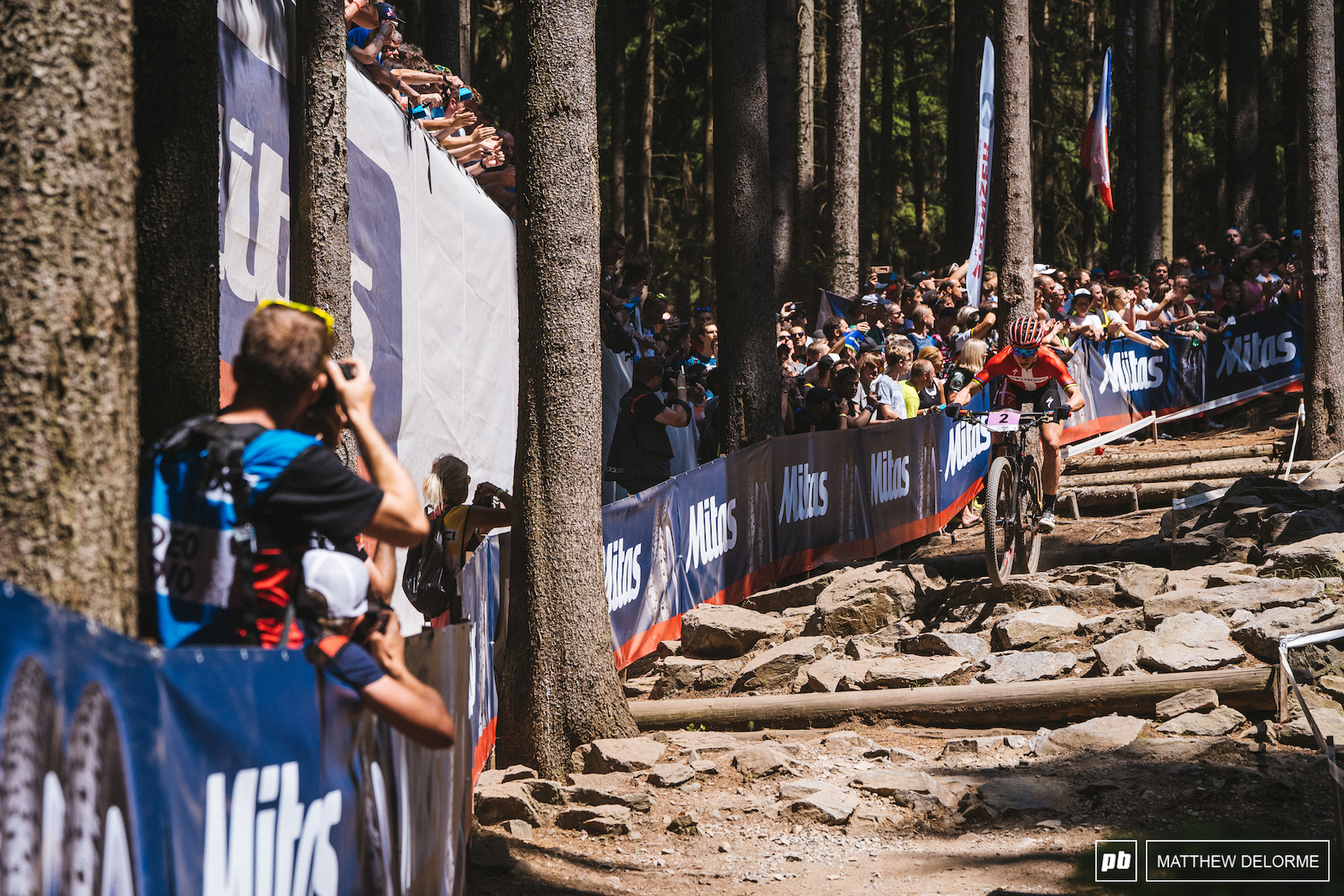 Annika Langvad charging in the rocks on Mitas Choice.