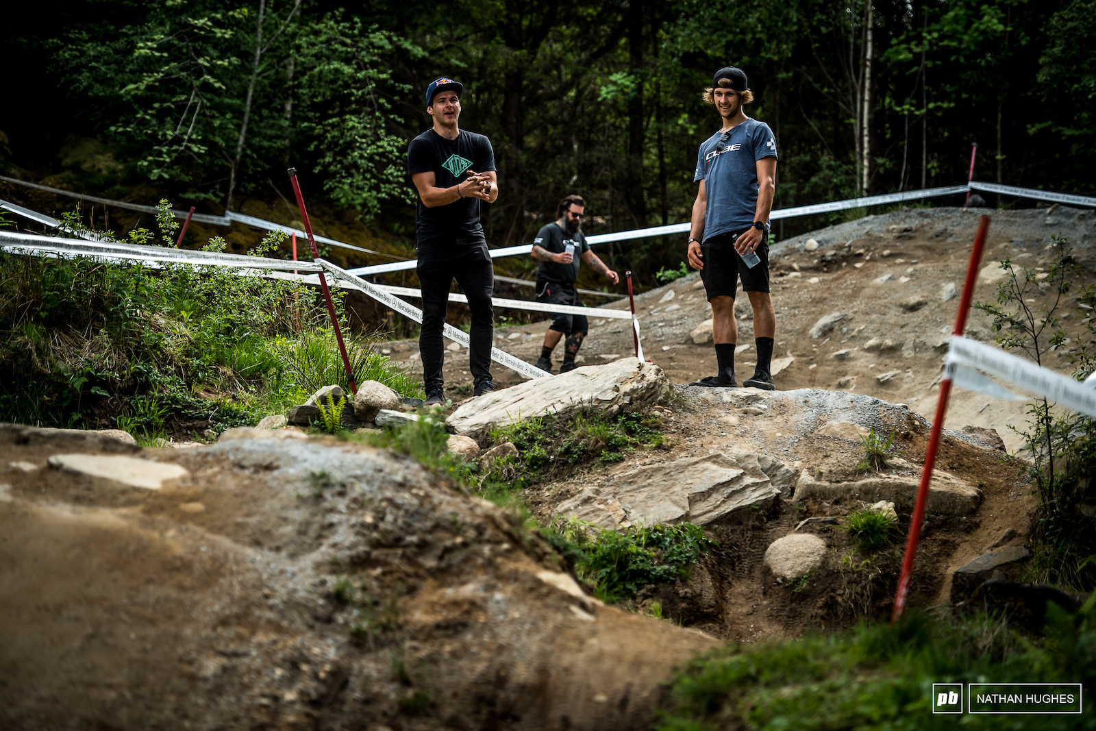 Enduro boss Greg Callaghan assisting Max Hartenstern s hike in the forest.