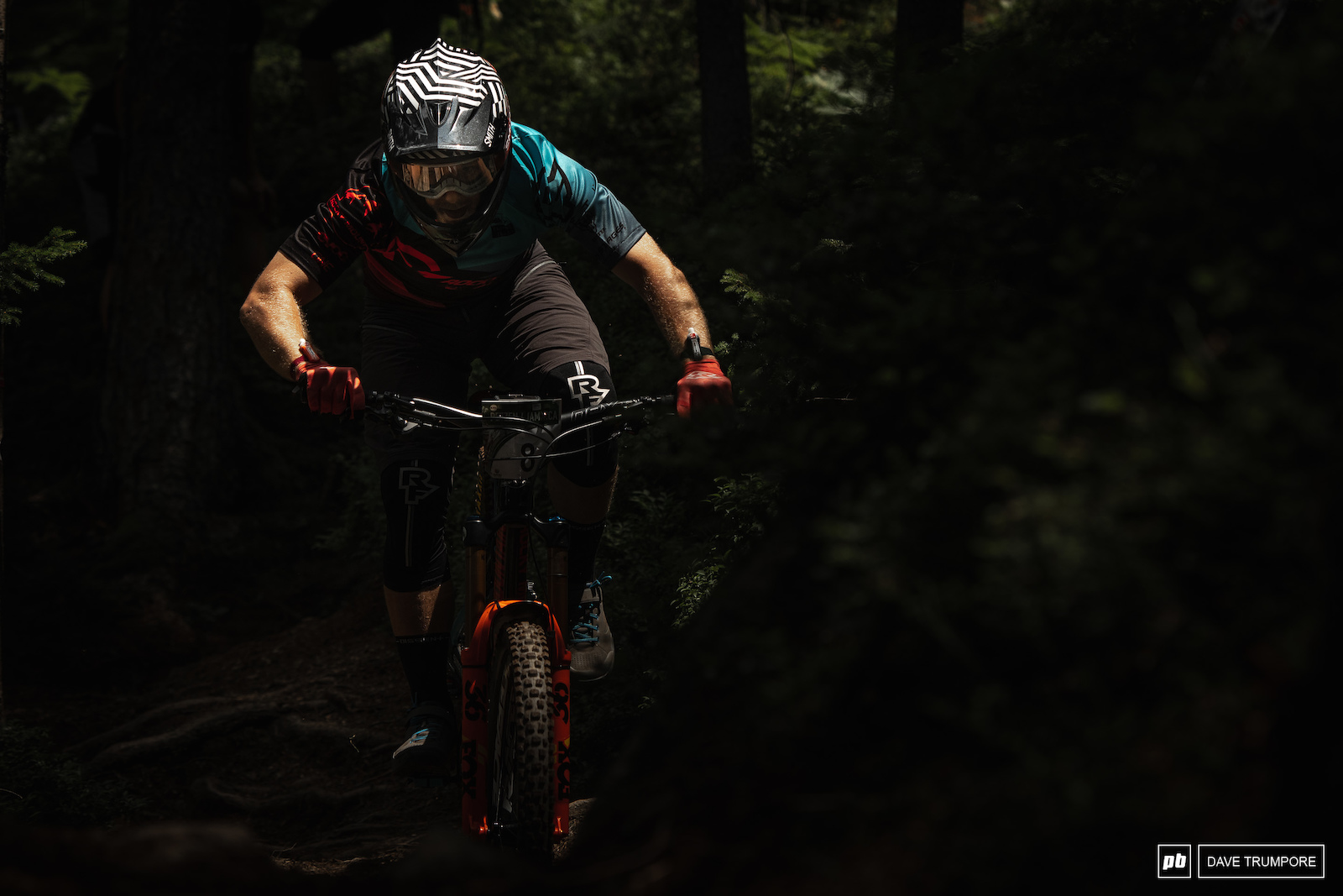 Remi Gauvin tries to spot the good lines through all the dappled light in the woods on top of Stage 1.