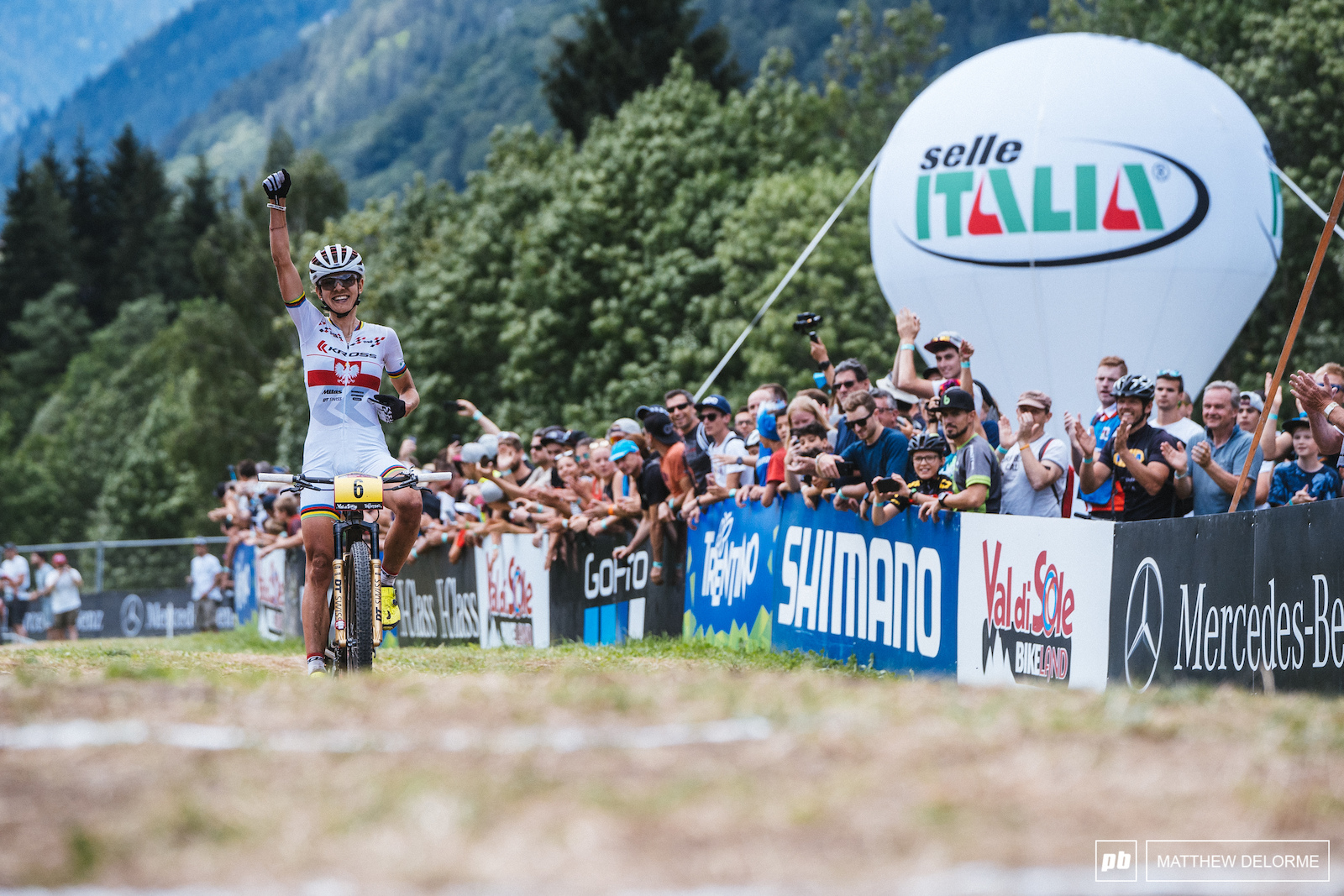 An ecstatic Maja takes a win here in Val di Sole.