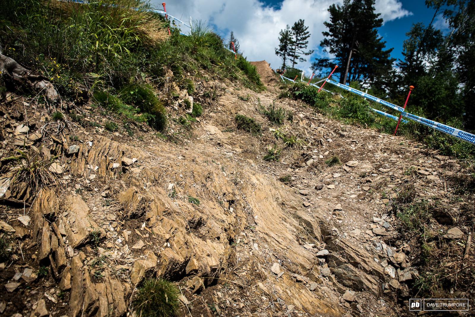 In between the berms and jumps are plenty of sharp rocks as the track has now aged to the point that there is little dirt left in some sections and only the bedrock.