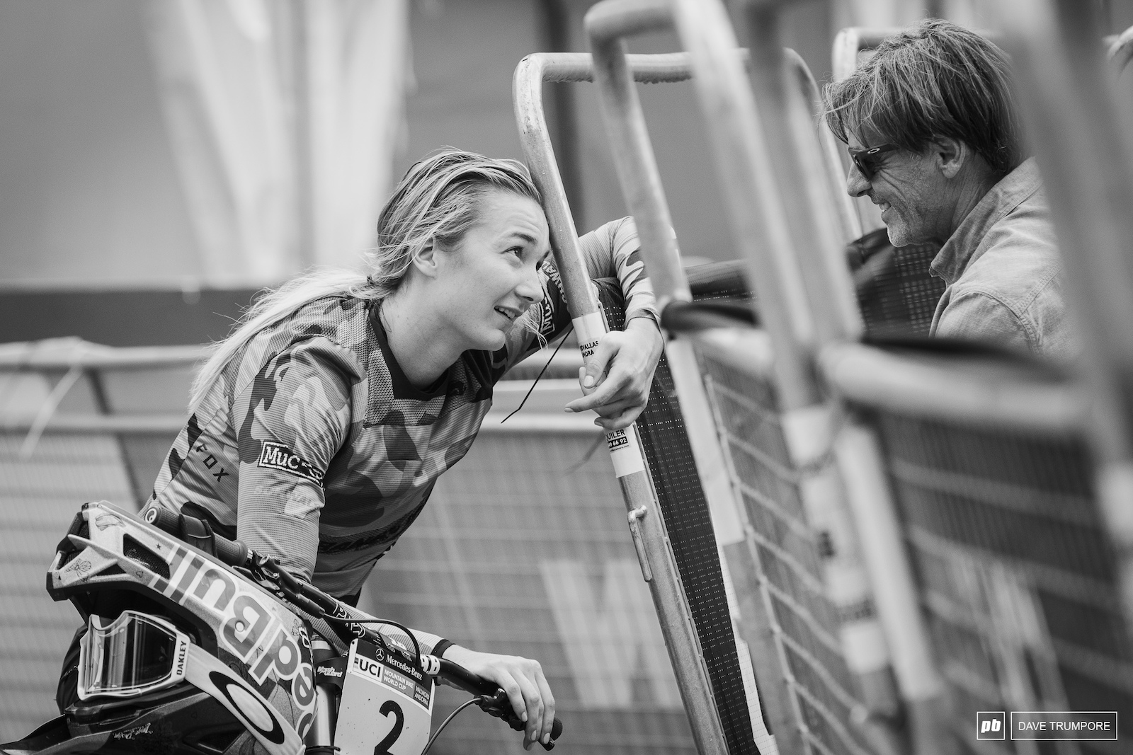 Tahnee Seagave checks in with Max Commencal at the finish line to see how Myriam Nicole is doing as she recovers from a back injury.